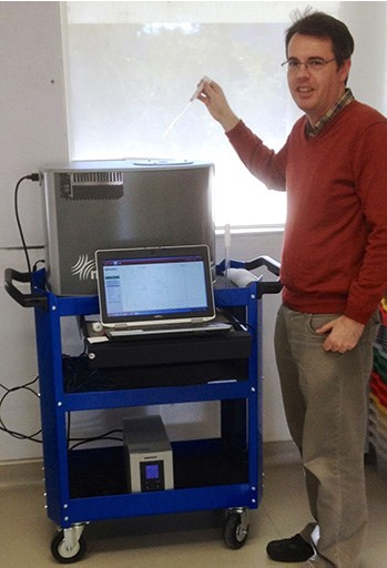 Dr Philip Sharpe with his Spinsolve NMR spectrometer