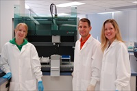 Forensic scientists Jennifer Jarrett Robert Binz and Heather Pevney with one of the DNA Sections Freedom EVO workstations
