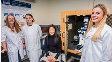 Professor Huabing Yin and her students with their JPK NanoWizard AFM with the CellHesion module at the University of Glasgow