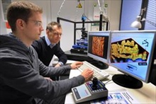 Professor Robert Magerle (right) watches Eike-Christian Spitzner working with the JPK NanoWizard AFM