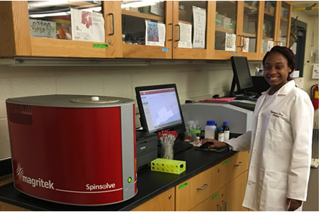Undergraduate chemistry major, Tytianna Drew, uses the Magritek Spinsolve benchtop NMR spectrometer