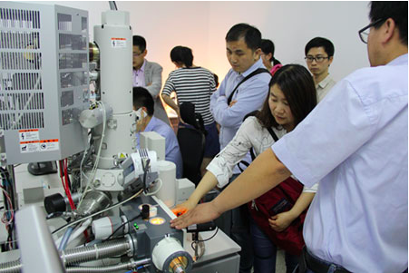 Visitors to Professor He's laboratory at Nanjing Agricultural University look at the Quorum PP3010T Cryo-SEM sample preparation system