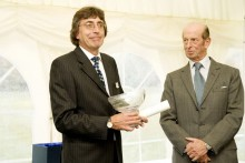 HRH The Duke of Kent presents the 2011 Queen's Award for Enterprise to Paul Walker (left), Managing Director of Malvern Instruments